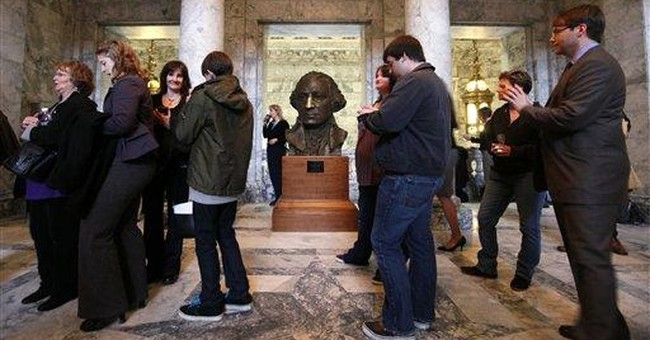 Washington gov signs gay marriage bill into law