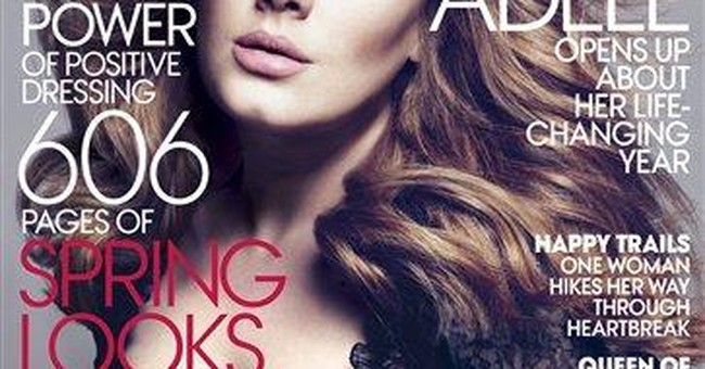 Adele tells Vogue she's done with break-up music