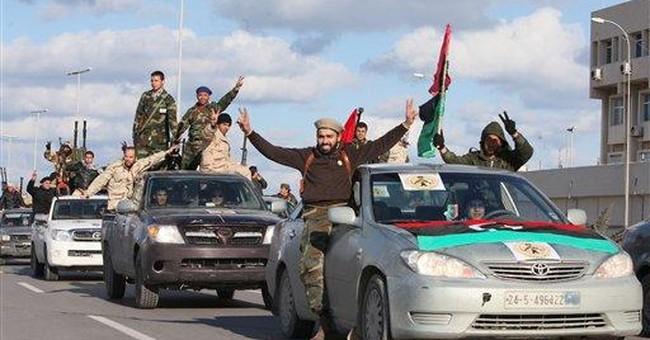Libyan militias parade through Tripoli
