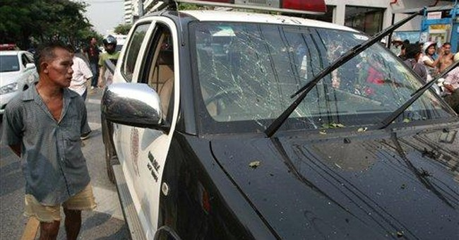 Bangkok blasts wound Iranian attacker, 4 others