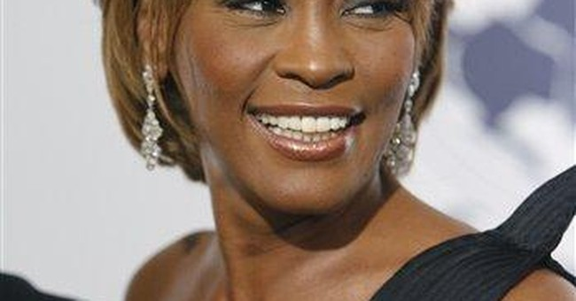 NJ flags to fly at half-staff for Whitney Houston
