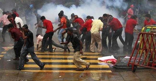 Sri Lanka police fire on fuel-cost protest; 1 dead