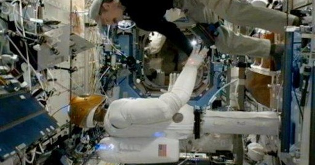 Human and humanoid robot shake hands in space 1st