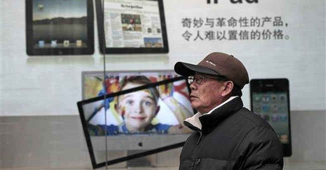 More Chinese cities seize iPads over trademark