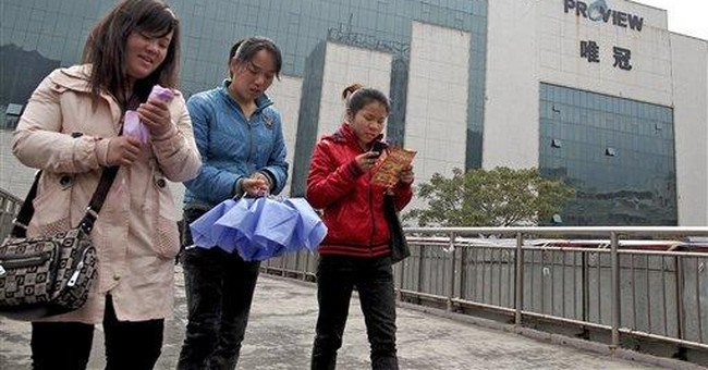 China faces conflict of law, business in iPad row