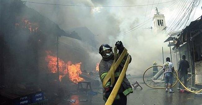 Fire sweeps 3 street markets in Honduras' capital