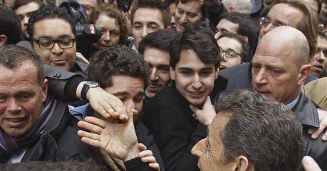 French President Sarkozy opens campaign HQ
