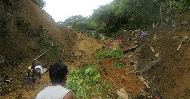 Landslide kills 25, buries more in Philippines