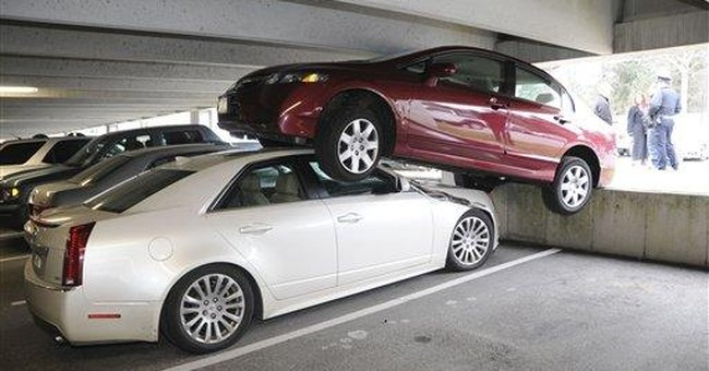 Car ends on top of another in Mass. parking garage