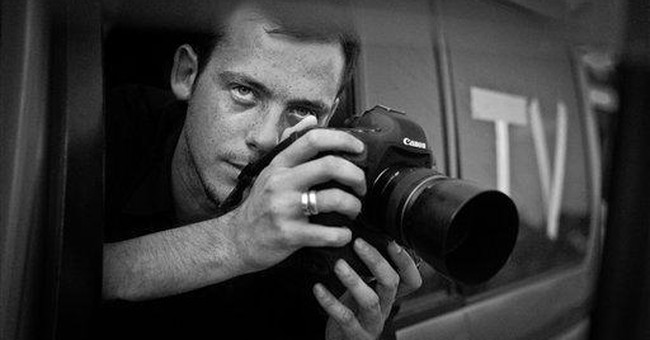 French photographer, 28, killed in Syria