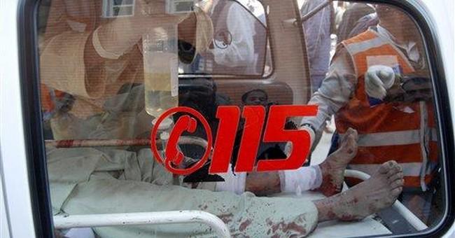 Car bomb at minibus terminal in Pakistan kills 12