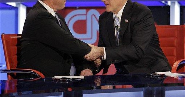 Romney hits Santorum for taking 'one for the team'