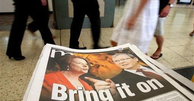 Australian PM calls party vote as challenger rises