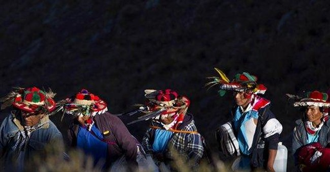 Huichol Indians trek to sacred site to oppose mine