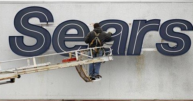 Sears shedding some stores, reports 4Q loss