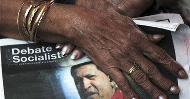 Venezuela's Chavez assures backers: 'I will live!'