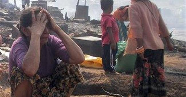 Fire burns shacks for Myanmar refugees in Thailand