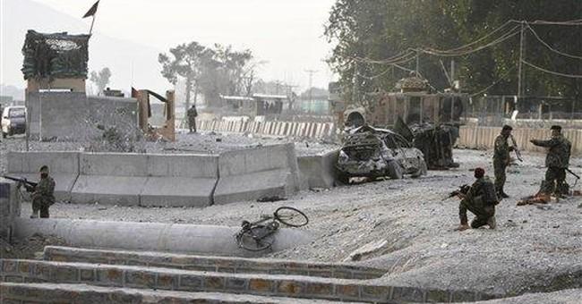 9 Afghans killed in blast outside NATO base