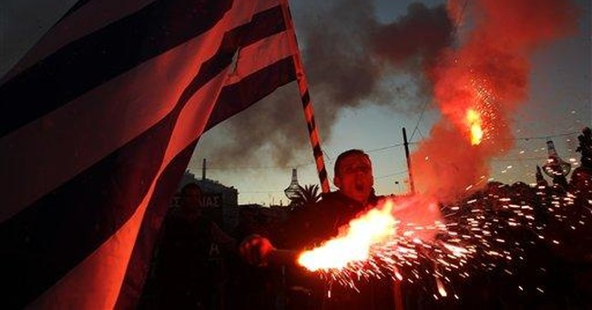 Greece approves tough salary, pension cuts