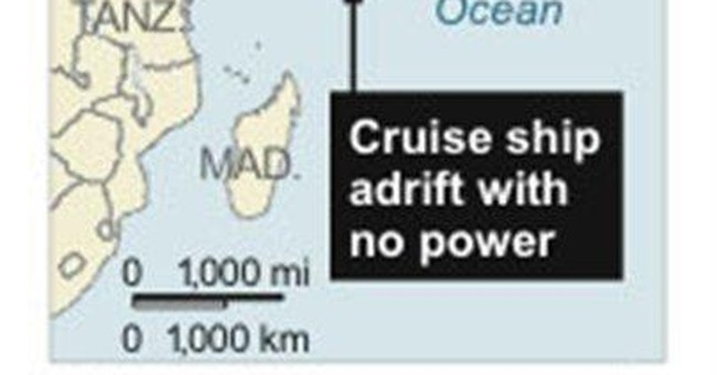 Official: Fight over cruise ship tow cost time