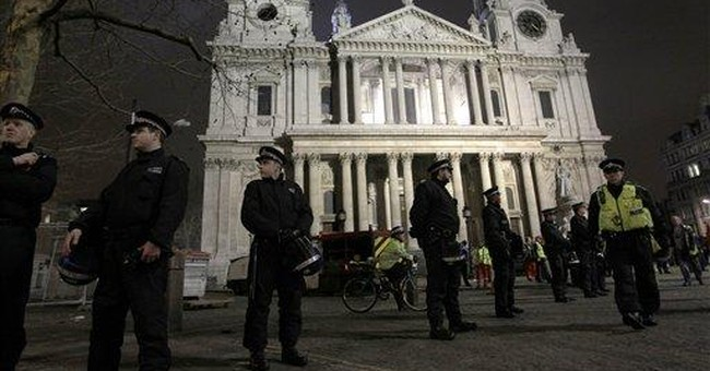UK police arrest 20 as they dismantle Occupy camp