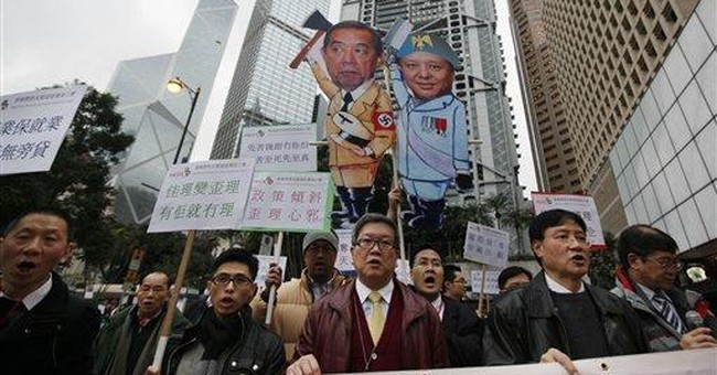 HK stockbrokers rally against cut to lunch break