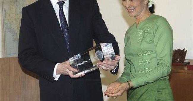 Britain's Hague says Myanmar needs more reforms