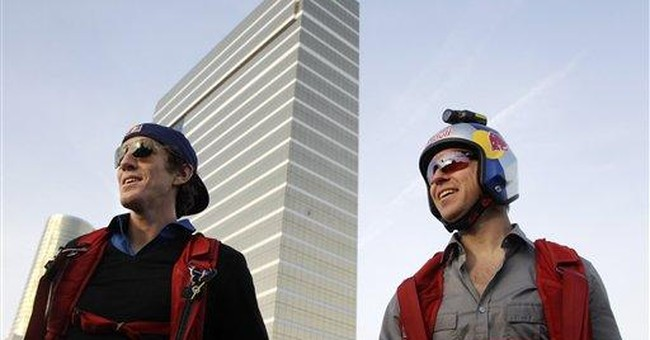 Parachutists jump off tall buildings for leap day