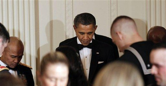 Obama salutes Iraq war vets at White House dinner
