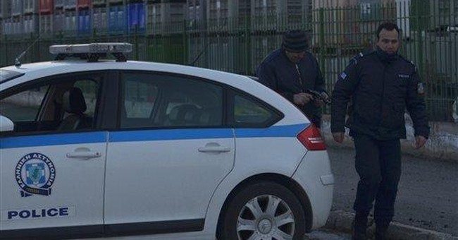 Greece hostage-taker surrenders to police