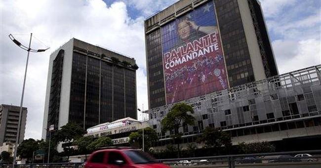 Venezuela's Chavez on state TV: 'I am doing well'