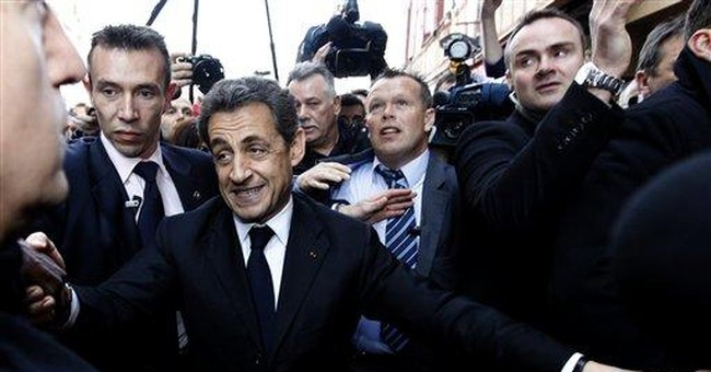 French leader holes up in bar to escape protesters