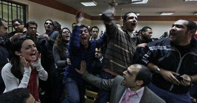 7 American pro-democracy workers fly out of Egypt
