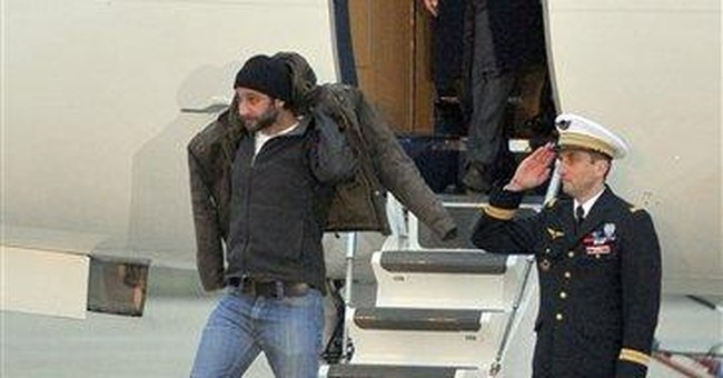2 French journalists who escaped Syria return home