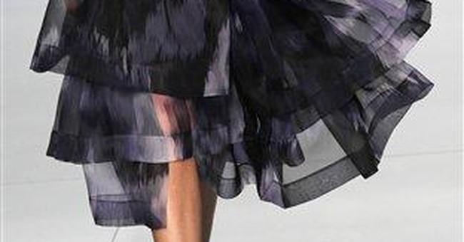 Dior hems plunge, Lanvin celebrates at Paris shows