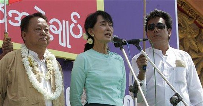 Aung San Suu Kyi campaigns in Myanmar's capital