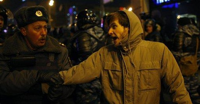 Riot police break up anti-Putin protest in Moscow