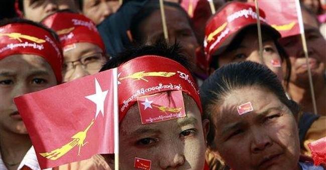Myanmar's Suu Kyi woos army during campaign stop