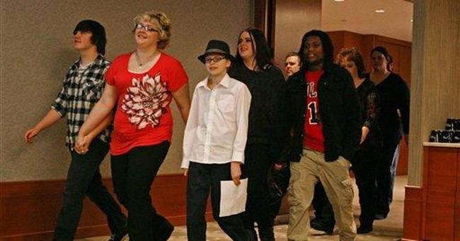 Justice Department hails Minn. school settlement