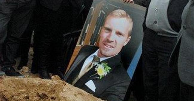 Fathers of US teacher, killer meet at Iraq funeral