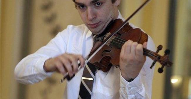 NY violin prodigy, now award-winning fundraiser