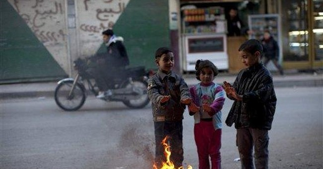 Syria's Assad determined to keep fighting