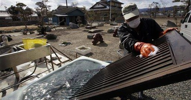 Japan cleans up radiation zone, unsure of success