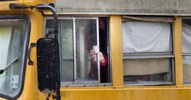 2 children found living in abandoned school bus