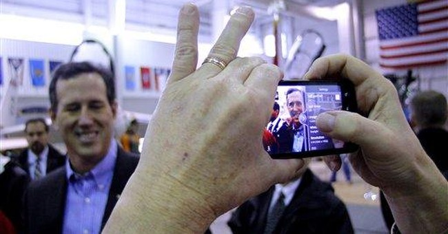 Santorum: Obama, Romney share distrust of America
