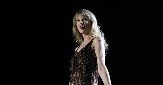Taylor Swift is Billboard's top money maker in '11
