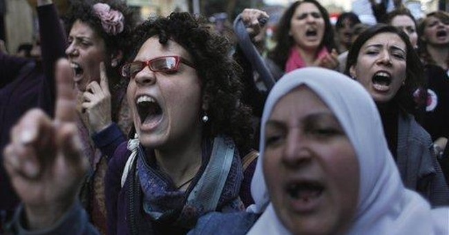 Egyptians protest against US funding of NGOs
