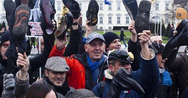 Shoe-toting protest urges German president to quit