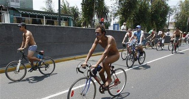 300 nude bicyclists hit Peru streets in protest
