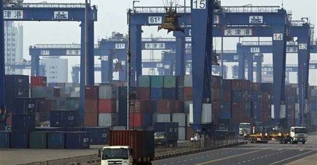 China reports rare trade deficit as imports jump